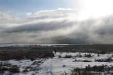 Snow on the moors with low clouds